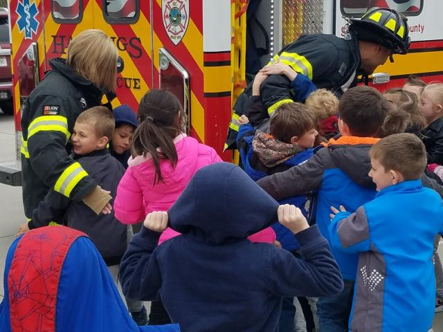 Kindergarten classes enjoying a visit from the fire department image