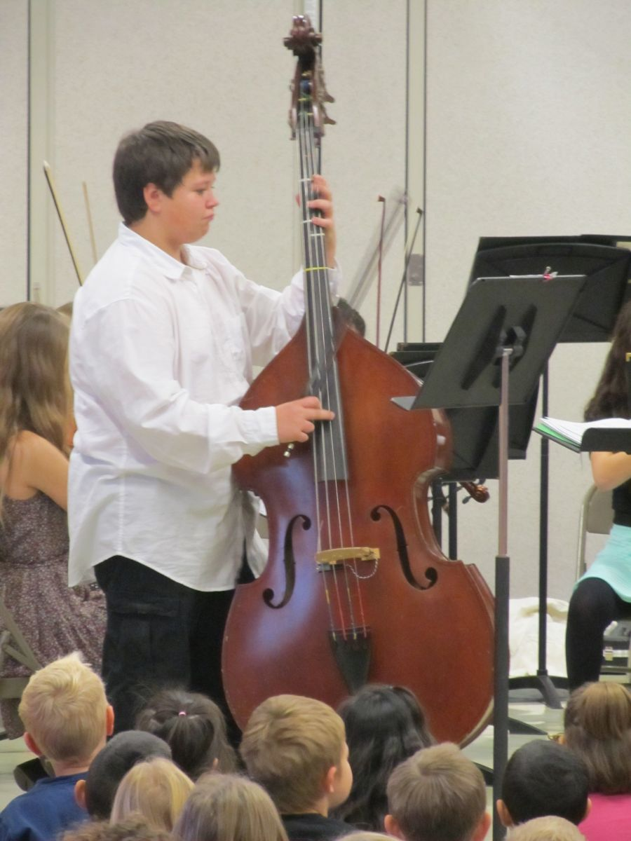 student playing bass cello